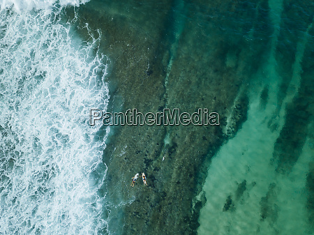 indonesia sumbawa aerial view of surfers