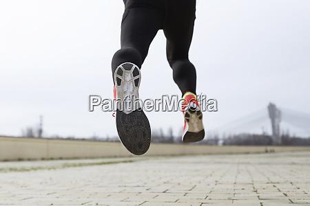 jogger running runners feet sole of
