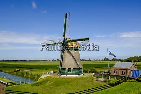 netherlands north holland zuiderdijk countryside windmill