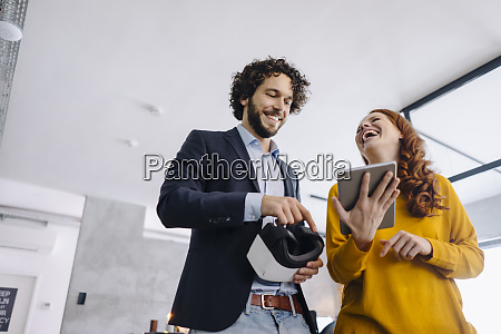 happy businessman and businesswoman with vr