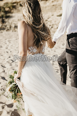 rear view of bride and groom