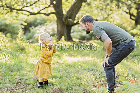 father and little daughter together on