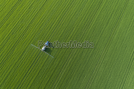 germany thuringia aerial view ofcrop sprayerlying