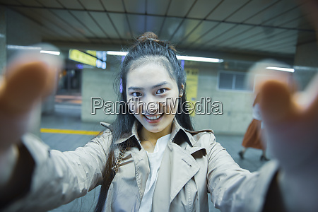 selfie portrait of smiling young woman