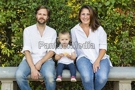 portait of parents with little daughter