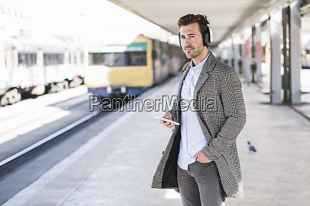 young businessman with cell phone and