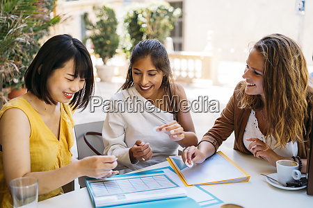 female multicultural students meeting in a