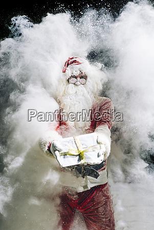 santa claus showing gift