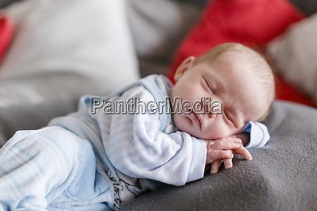 newborn baby boy sleeping on a