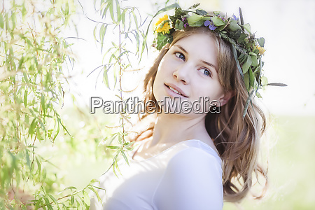 young woman with floral wreath in