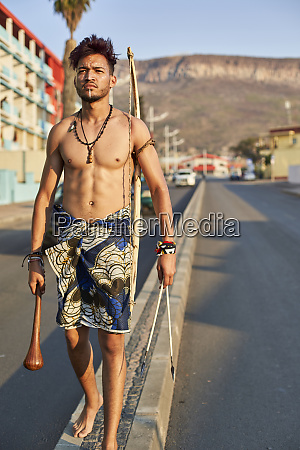 tribal man with his traditional arch