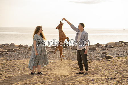 young couple with dog at the