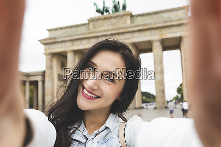 selfie of happy young woman at