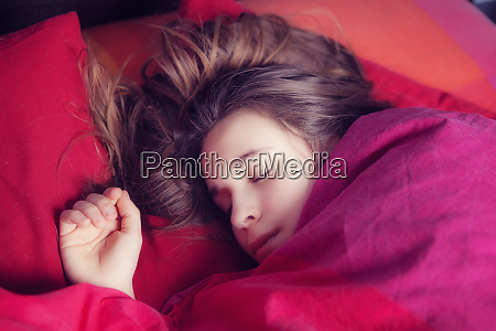 portrait of girl sleeping in colourful