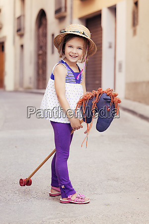portrait of little girl with hobby