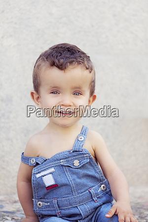 portrait of little boy wearing denim