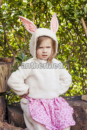 portrait of angry little girl wearing