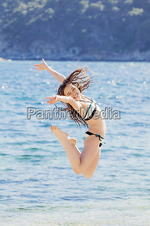 portrait of girl jumping in the