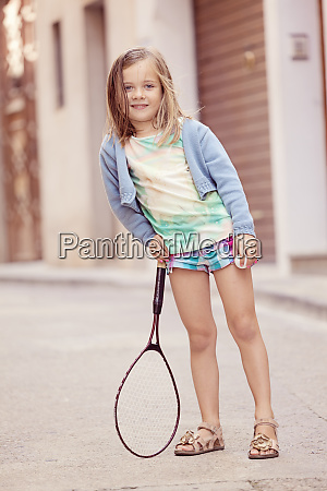 girl with a tennis racket