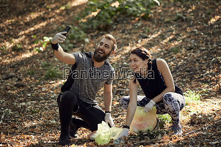 couple taking a selfie during plogging