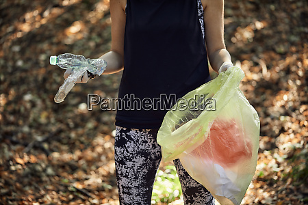 woman plogging in forest