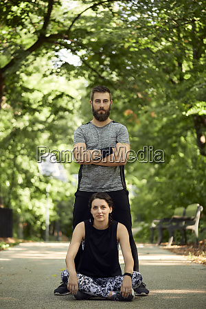 portrait of sporty couple on forest