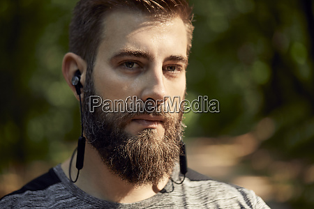 portrait of sporty man with earphones