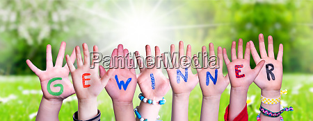 children hands building word gewinner means