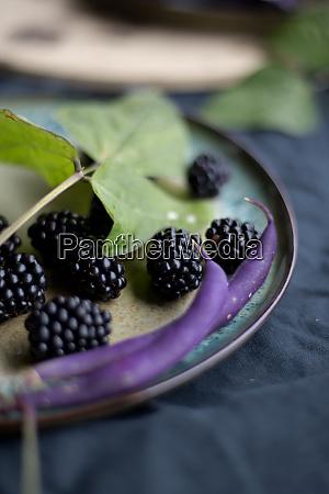 purple food blackberries beans and sage