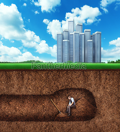 businessman has a rest while digging