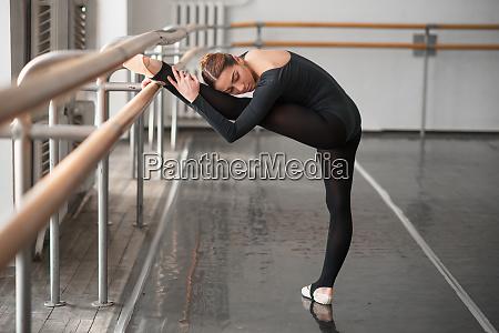 skill ballet dancer posing in class