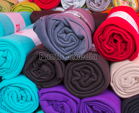 rolled colorful fleece blankets