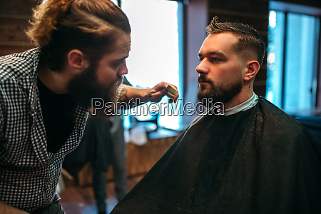 barber styling mustache and beard at