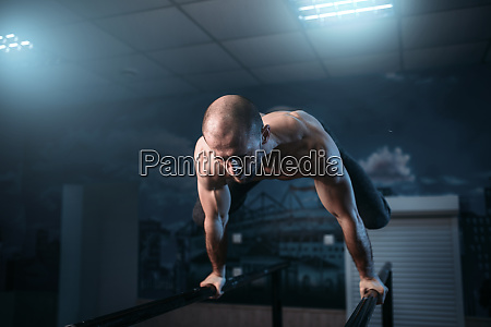 horizontal balance exercises on gymnastic bars