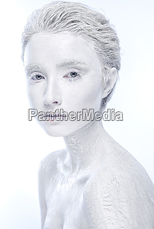 naked frozen female woman covered in