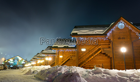 ski chalets at night