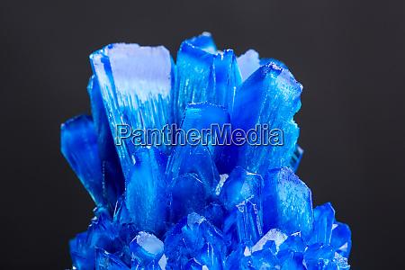 blue salt crystal isolated on black