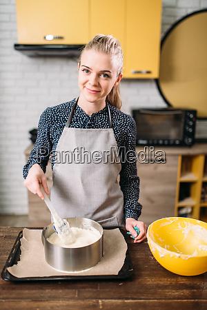 woman cook prepares cake ingredients in