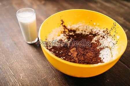 bowl with dough chocolate powder glass