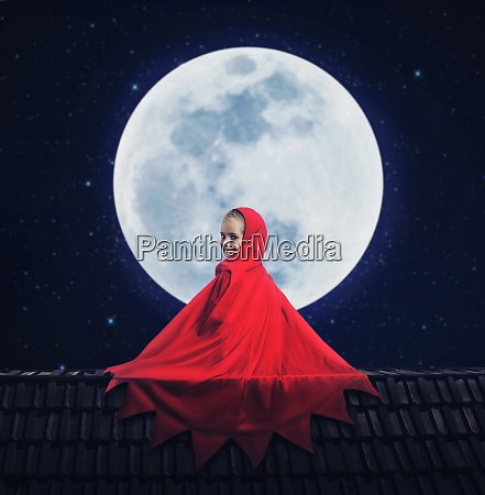 little girl in a red gown