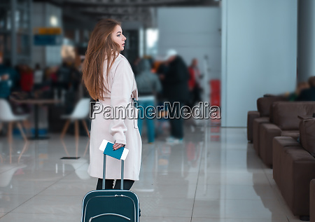 traveller walking the airport hall