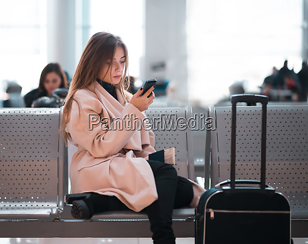 airport business woman waiting in terminal