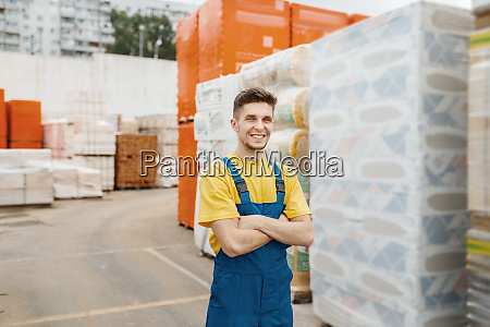 male builder at the pallets of