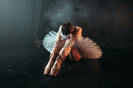 ballet performer sits on floor body