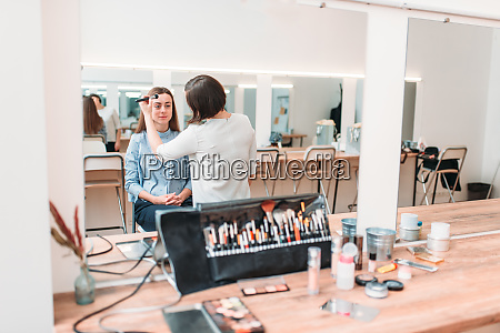 female make up artist work with