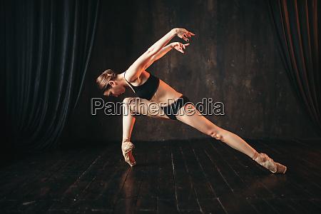 classical ballet dancer in black practice