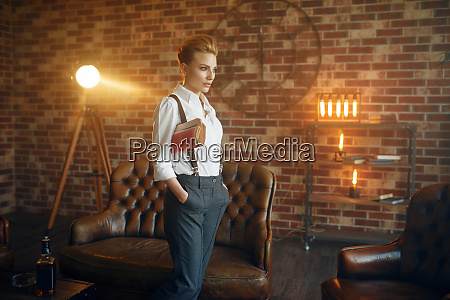 woman in shirt and trousers with
