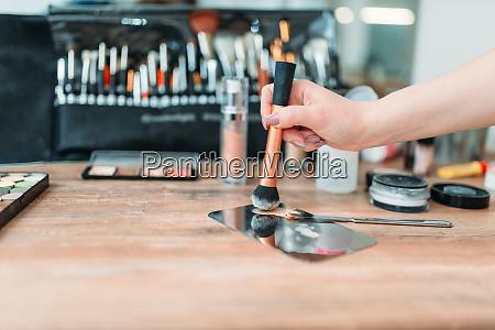 make up artist hand with brush