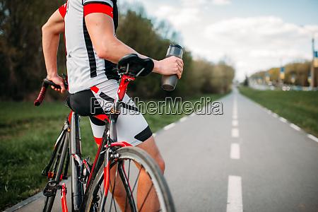 bycyclist in helmet and sportswear on