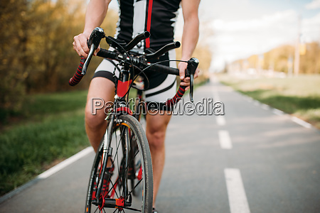 cyclist in helmet and sportswear bicycle